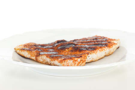 broiling: Low-fat chicken filet on white dish