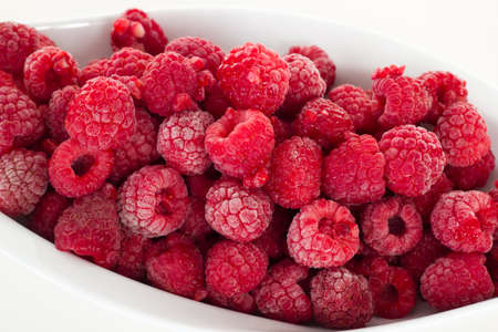 Frozen raspberries in white dish