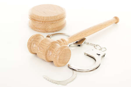 Wooden gavel with handcuffs Stock Photo