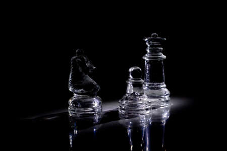 Some chess pieces in the darkness photo