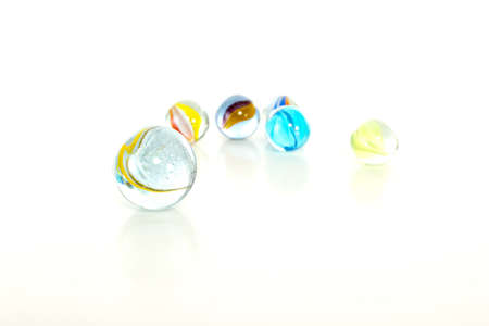 Colourful marbles on white background photo