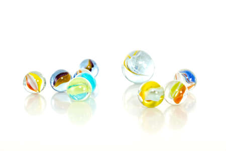 divergence: Colourful marbles on white background