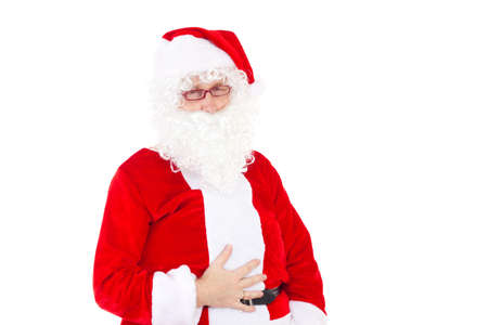 Santa Claus has eaten too much cookies photo