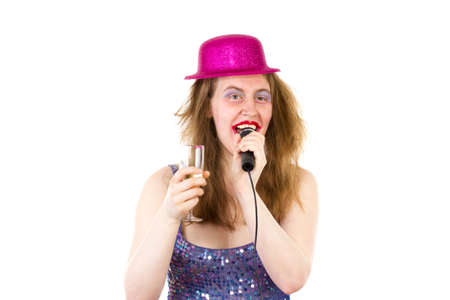 Woman singing karaoke and drinking sparkling wine photo