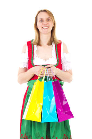 Smiling woman in red dirndl is happy about new clothes photo