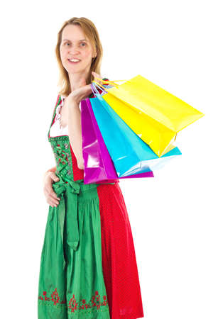 Bavarian woman in dirndl on shopping tour photo