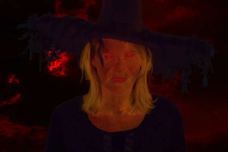 credence: Dark witch in front of drastic black bloody sky Stock Photo