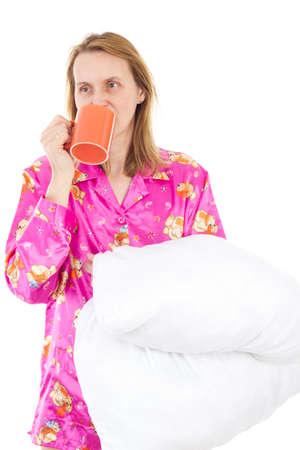 Sleepy woman drinking morning coffee photo