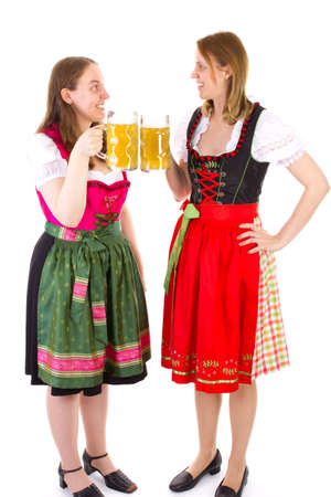 well known: Beautiful girls in dirndl clinking their glasses