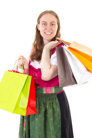 well known: Beautiful woman in dirndl on shopping tour