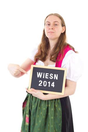 wiesn: Young bavarian woman shows blackboard   Wiesn 2014 Stock Photo
