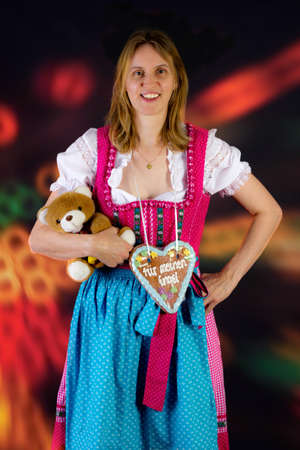 Woman with teddy and gingerbread at fun fair photo