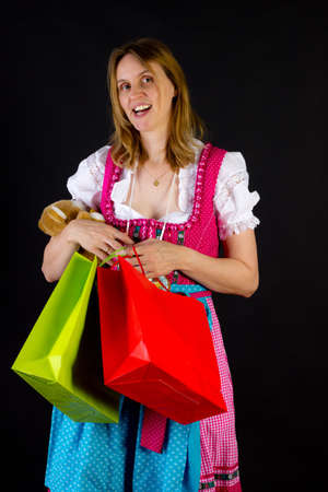 Woman in dirndl on shopping tour photo