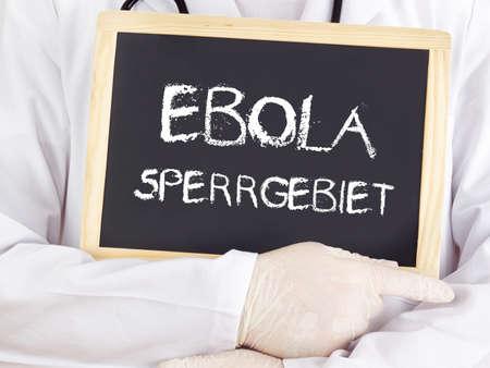 area restringida: El doctor muestra informaci�n: zona restringida del Ebola en alem�n