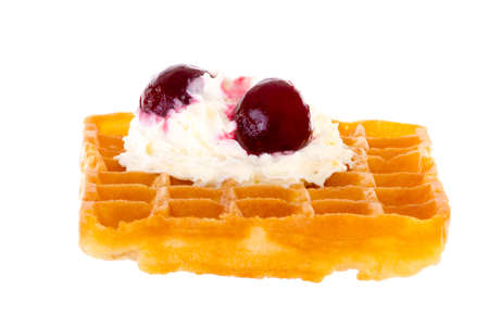 Cherries and whipped cream on freshly baked waffle brightened photo