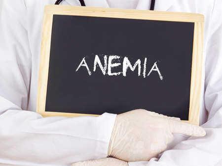 anemia: Doctor shows information on blackboard: anemia