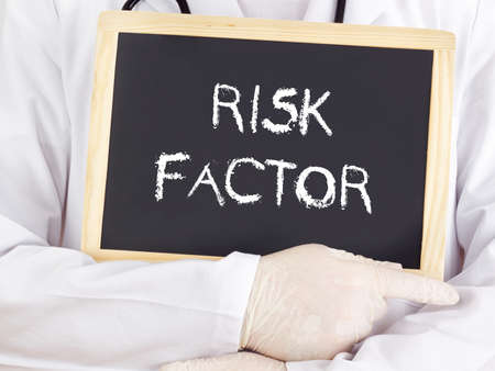 factor: Doctor shows information on blackboard: risk factor Stock Photo