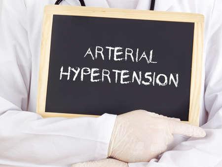 htn: Doctor shows information: arterial hypertension Stock Photo