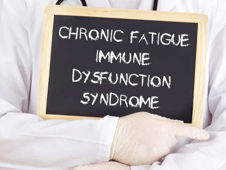 dysfunction: Doctor shows information: chronic fatigue syndrome immune dysfunction syndrome Stock Photo