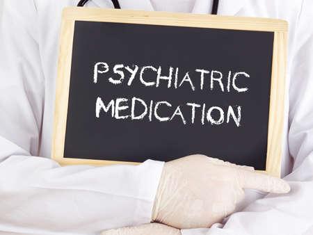 psychiatric: Doctor shows information: psychiatric medication Stock Photo