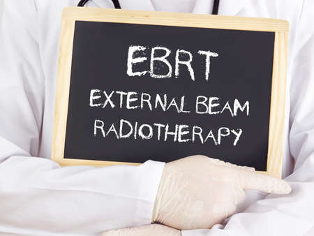 radiotherapy: Doctor shows information: EBRT external beam radiotherapy Stock Photo