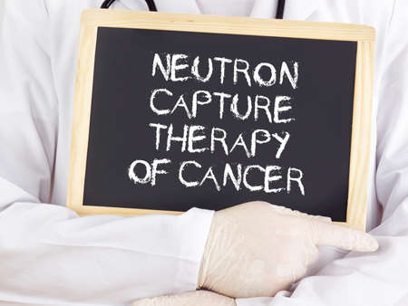 neutron: Doctor shows information: neutron capture therapy of cancer Stock Photo