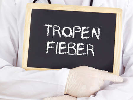 Doctor shows information: Tropical fever in german