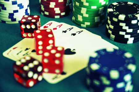 dices on poker cards with stack of gambling chips. cross precessed photography Stock Photo