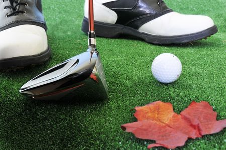 driving golf ball in autumn