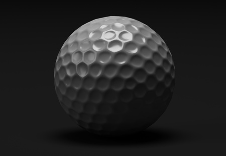 golf ball macro in low key, donkere achtergrond Stockfoto