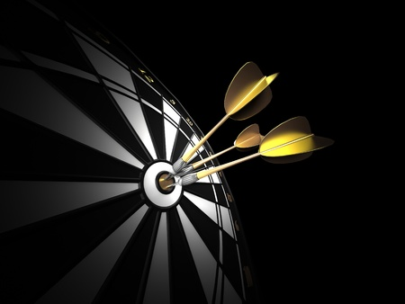 three gold darts hitting the center of a black and white dartboard. low key image. Standard-Bild