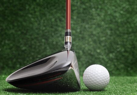 wedge: golf club on green background - driver Stock Photo