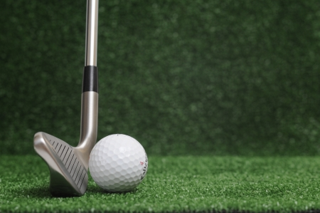 golf club on green background - iron 6 photo