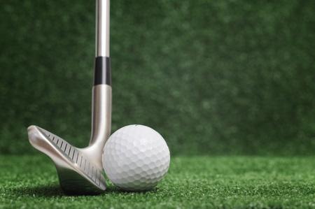 wedge: golf club on green background - wedge