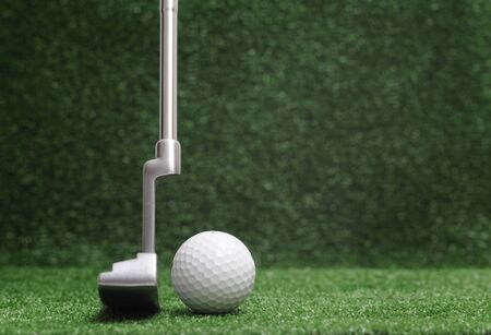 putter: golf club on green background - putter Stock Photo
