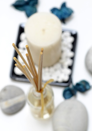 relaxing Spa decorations on white background - focus on fragrance sticks  photo
