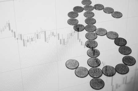 valorization: Stock chart on pc screen & dollar sign.