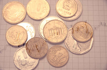 escalating: Growth market chart. World coins. Financial concept.