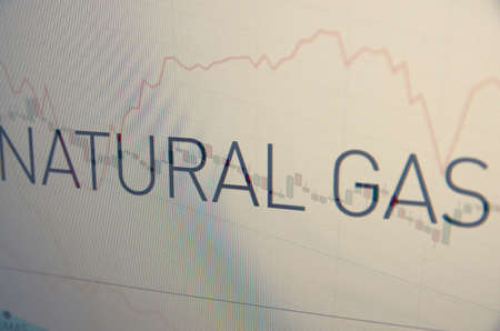 climbed: Inscription Natural gas on pc screen. Financial concept.