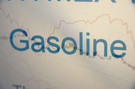 natural gas prices: Inscription Gasoline on pc screen. Stock charts. Financial concept. Stock Photo