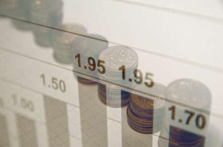 escalating: Financial concept on PC screen. Financial data & coins.