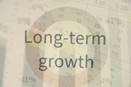earnings: Inscription Long-term growth. Corporate earnings concept. Stock Photo