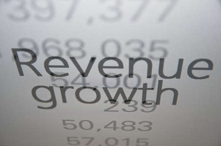 sell shares: Inscription Revenue growth on PC screen. Financial concept.