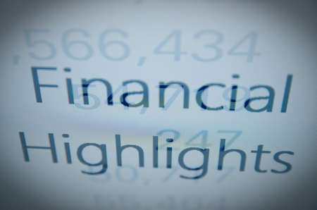 consolidated: Inscription Financial highlights on PC screen. Financial concept. Stock Photo