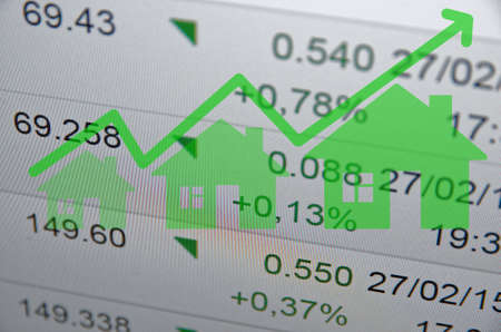 information median: Growing housing market. Green house icon with arrow. Stock Photo