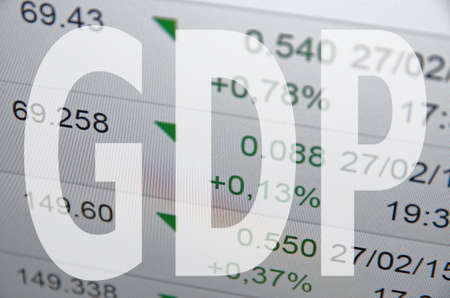 domestic: Inscription GDP Gross domestic product on PC screen. Financial data on background. Stock Photo