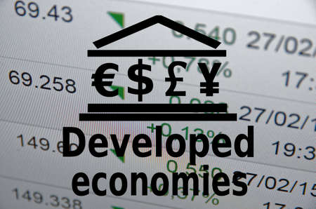 developed: Building icon with major world currencies symbols. Inscription Developed economies.