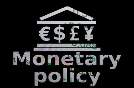 monetary: Building icon with major world currencies symbols. Inscription Monetary policy.