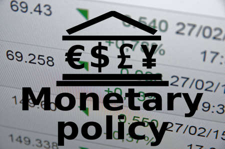Building icon with major world currencies symbols. Inscription Monetary policy.