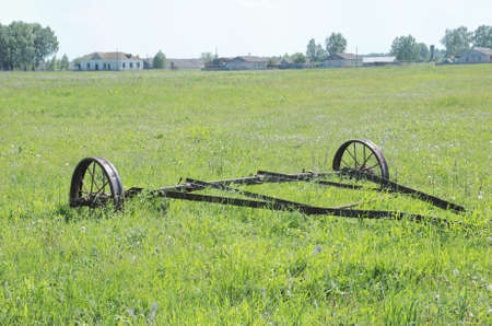 spoked: Rusty big old farming plough. Rural view